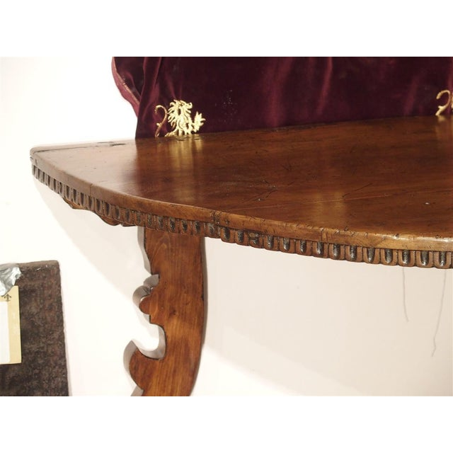 This half round table was made in Italy, in the early 1700's. Tables of this type were first constructed in the mid to...