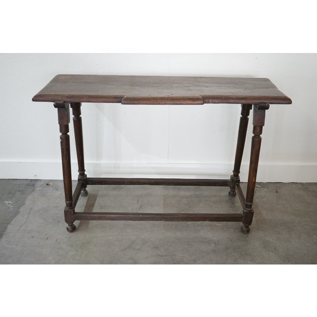 This 19th century Spanish wood console has the most beautiful and clean lines. The console raised with striking turned legs.