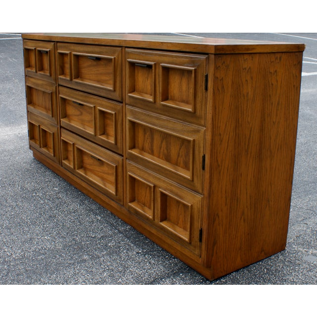 Mid-Century Modern geometric credenza by Bassett Furniture Industries. This credenza features 3 drawers in the center and...