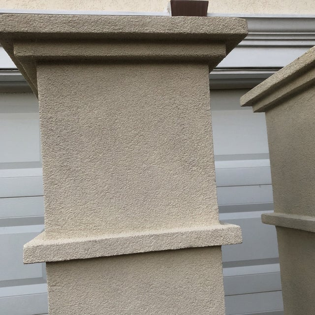 Stately pair of architectural columns are perfect for accenting space. Fiberglass material makes them lightweight and easy...