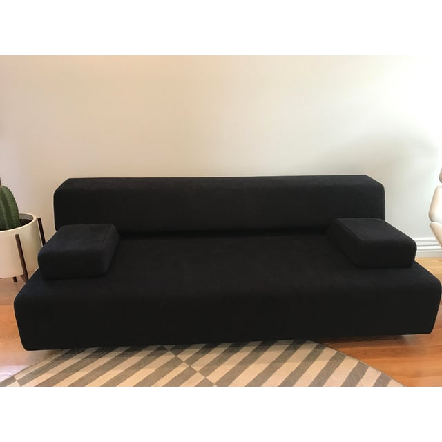 Black fabric DDC Cosma Sleeper Sofa. Once open, is between full and queen size bed that can easily sleep two. Very...