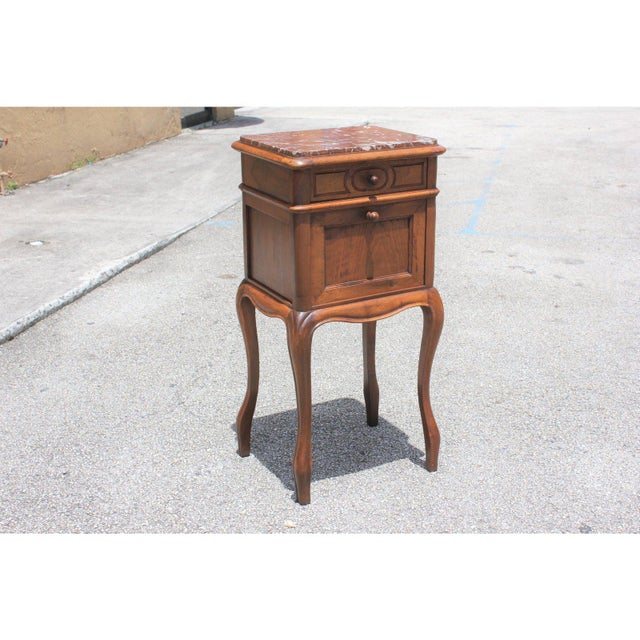French Louis XV solid walnut night stand or side table marble top. Circa 1900s. The table are in solid walnut with marble...