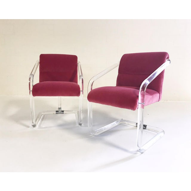 We love the design of this lucite pair. The center leg stemming from the seat adds a bit of interest to the overall simple...