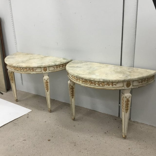1920 vintage Italian console tables. Great quality-original paint and water-gilt carved decorations. Carvings are not...