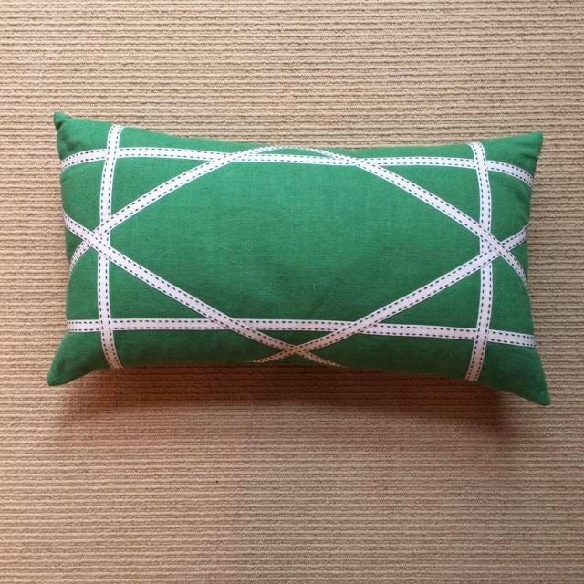 An apple linen pillow with lattice work made by ribbon. Please notice the little details such as the navy stitching on the...