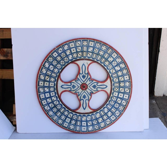 1930s hand-painted wooden game wheel. This piece would be a great addition to a home that loves to entertain guest and...