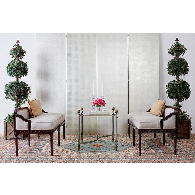 Large pair of faux ivy or evergreen topiary trees in wooden boxes. Standing 6 feet tail with three ivy balls on a metal...