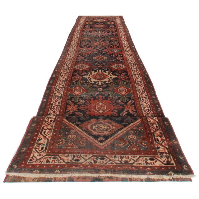 Crafted of hand-knotted wool, this Persian Malayer runner features an all-over geometric design.