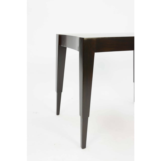 A wonderful and elegant lamp table by Johan Tapp refinished in a dark walnut lacquer.