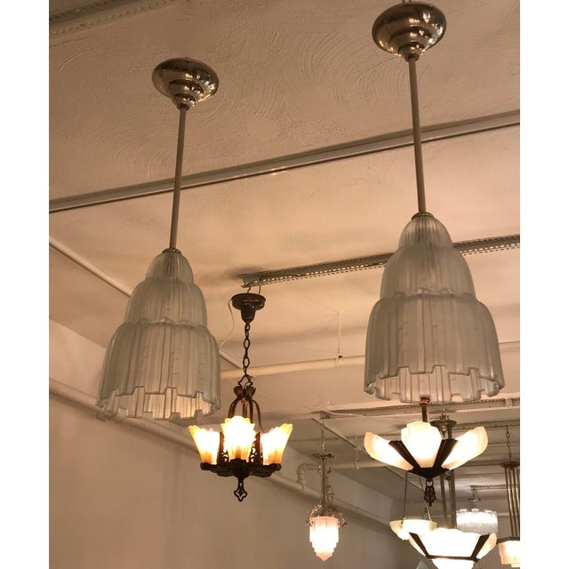 Pair or single French Art Deco chandeliers created by French artist Marius Ernest Sabino. These shade are known as the...