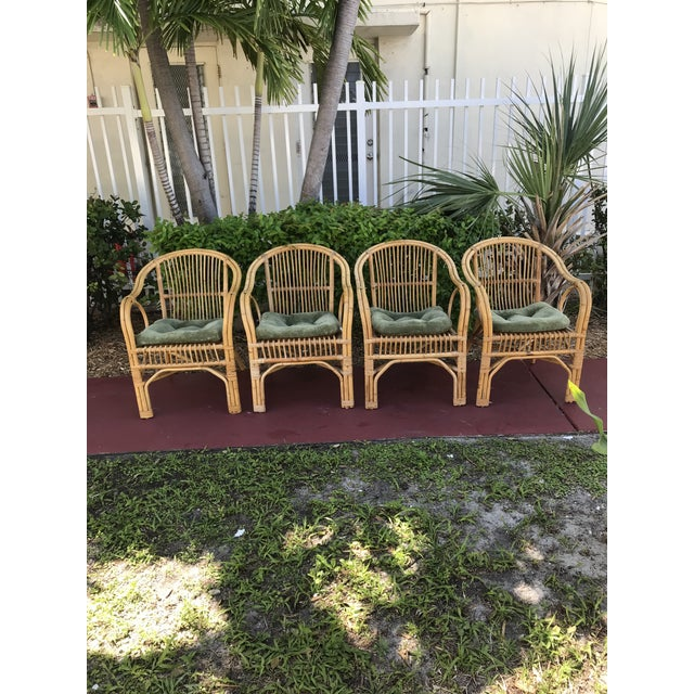 Great set of 4 boho chic bamboo chairs having great form and a wonderful patina they are super sturdy well cared for and...