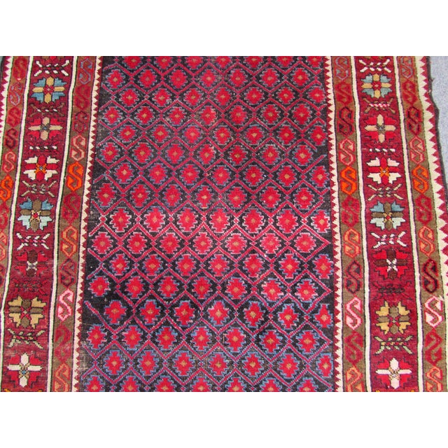 Handmade antique Baluch rug from Afghanistan in all-over design. The rug is in original condition, some low pile....