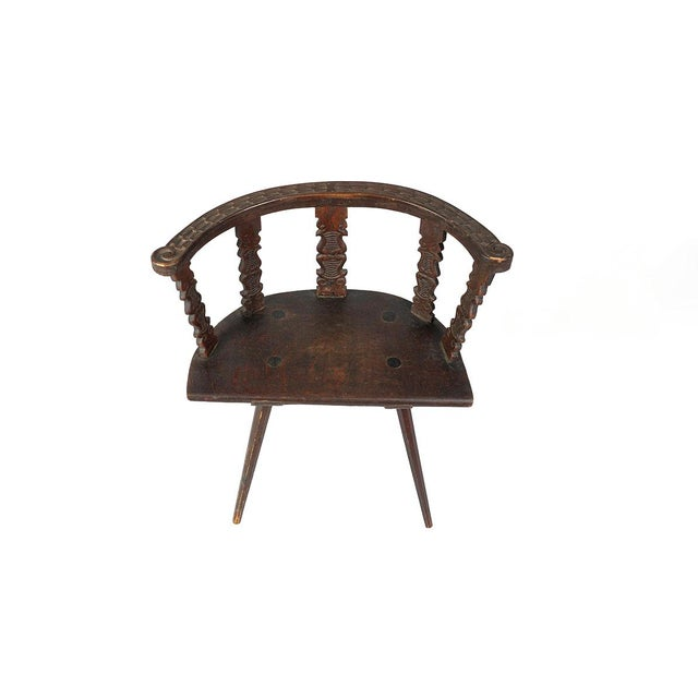 A most curious arm chair - Jacobean revival in style, elongated barrel back with carved top rail and superbly formed...