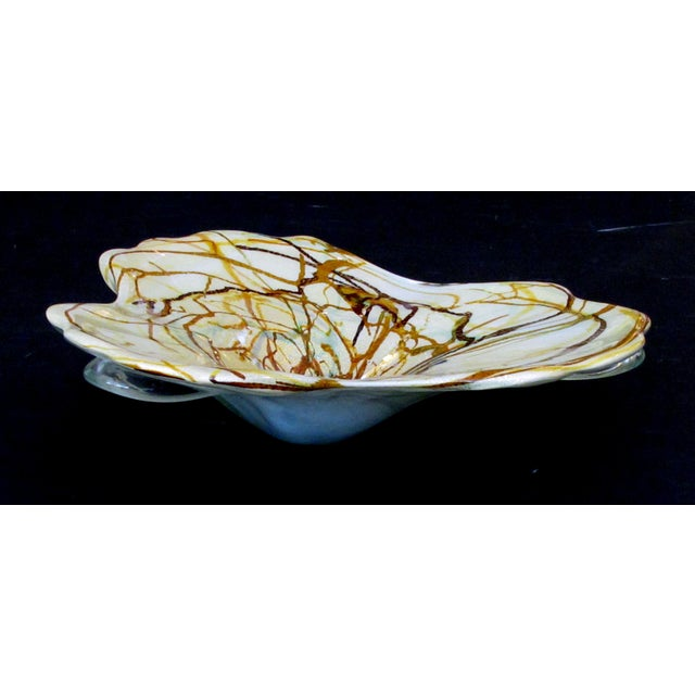 of impressive size, the cased glass bowl with swirl decoration in brown, gold and copper on a butter-yellow ground