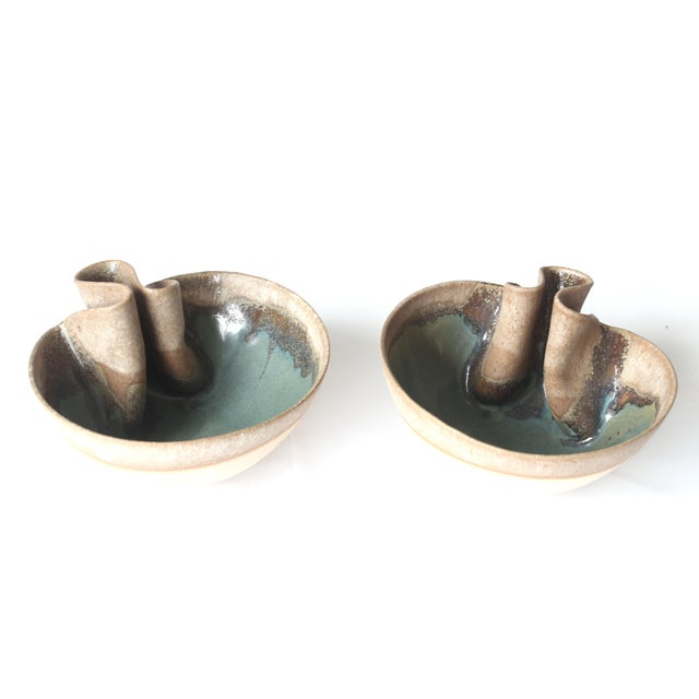These earthy colored glazed, folded bowls make for a beautiful accent atop any dresser or bookshelf. Made in the style of...