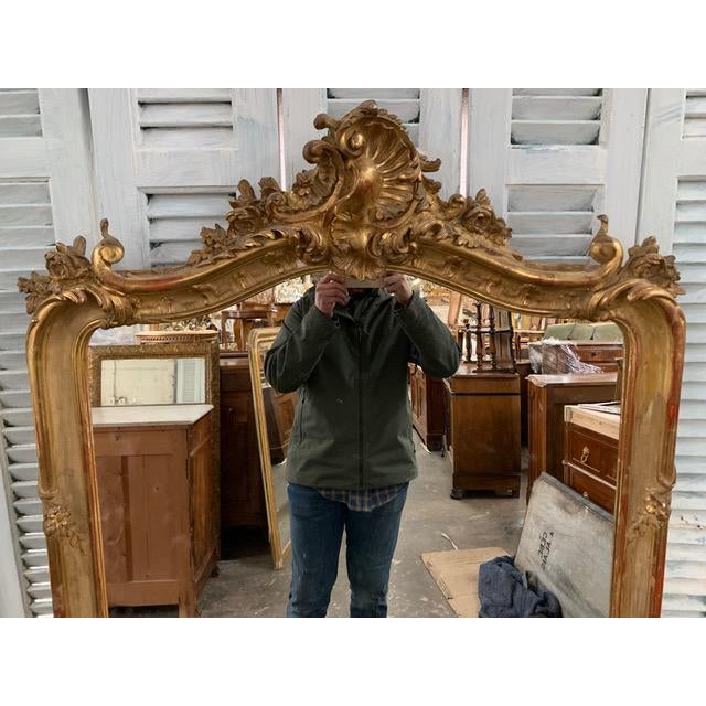 Original 18th Century Ornate hand Carved Grand French Louis Philippe mirror beautifully showcases the classic details of...