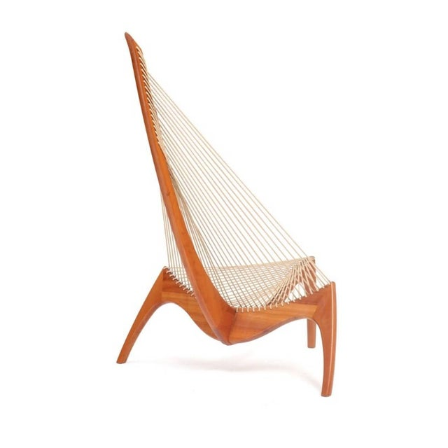 """""""The Harp Chair"""". A cherrywood easychair mounted with flag-haylard. Designed 1963. Manufactured by cabinetmaker Jørgen..."""