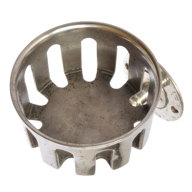 A vintage soap dish mount, possibly nickel material.