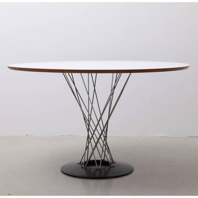 Isamu Noguchi table for Knoll Associates Inc. Model #312 with a Formica top. Tiny chips on the edge. Very good original...