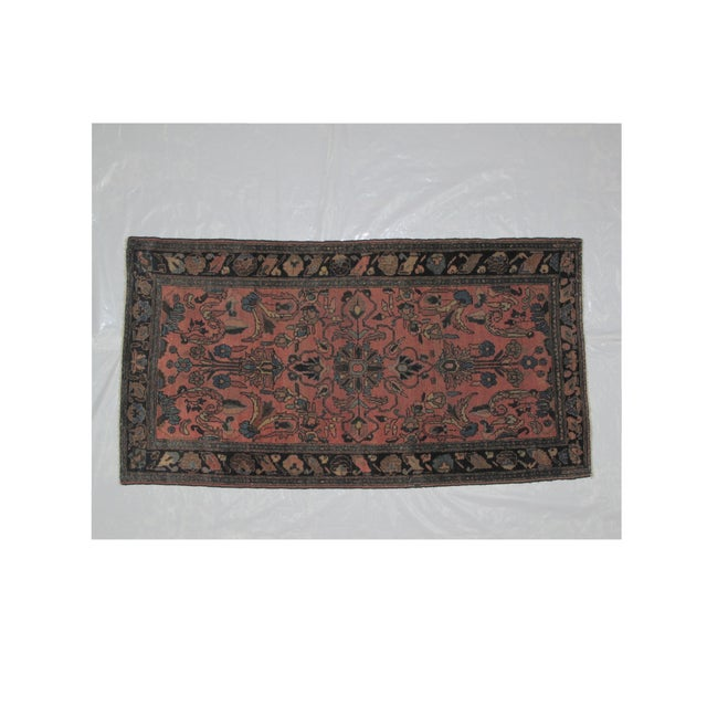 Wool pile hand woven antique Persian Lillihan rug in excellent condition.