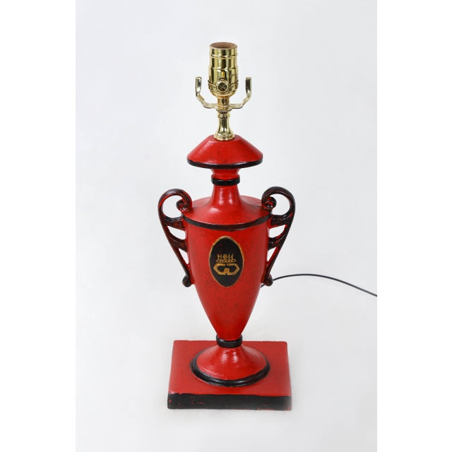 This Vintage red urn lamp with hand painted gold symbols in front and back from cypher of Duchesses & Duke of Windsor....
