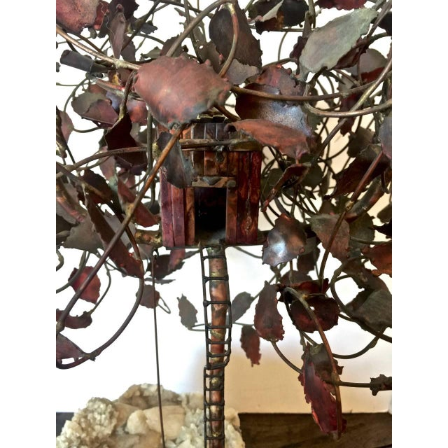 This is a large and fanciful Brutalist-inspired brass and copper sculpture of a child's imaginary play scene. The tree...