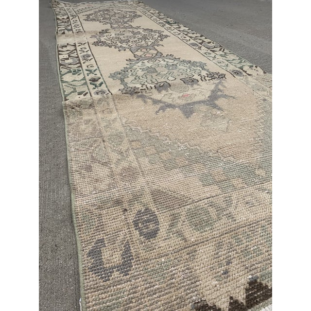 This is a gorgeous well worn Oushak runner from the 1950s. Oushak rugs originated in the small town of Oushak in west-...