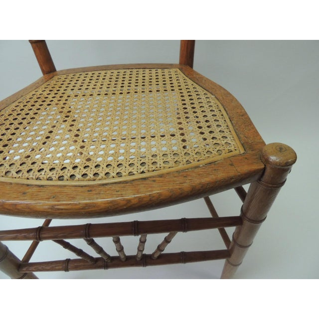 English 19th century English bamboo and rattan ballroom chair Bamboo, rattan and honey color, faux bamboo side chair with...