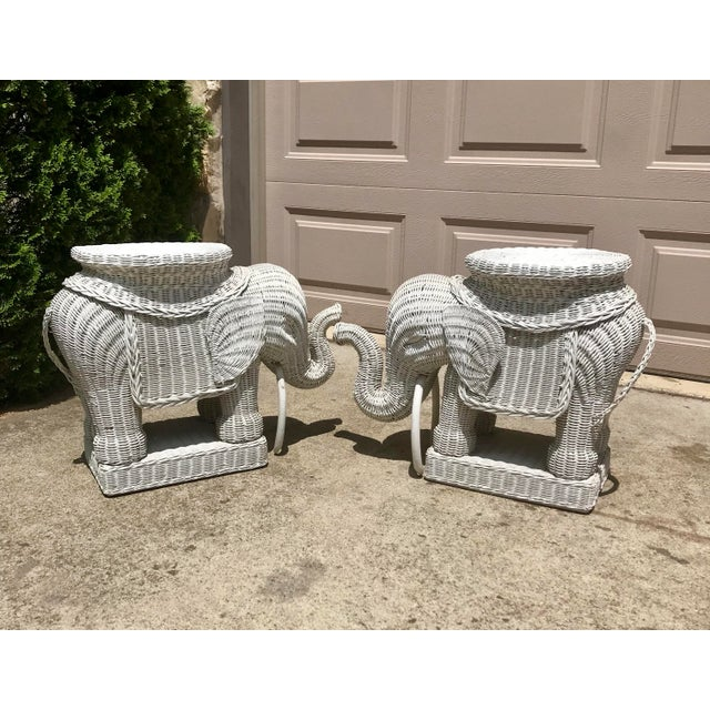 Vintage white painted wicker elephants. Painted during crafting process. Can be used as side tables, plant stands or...