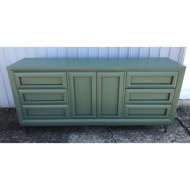 Mid Century Style Thomasville Dresser. 9 drawers total with 6 exterior and 3 behind the cabinet doors. Redone in a...