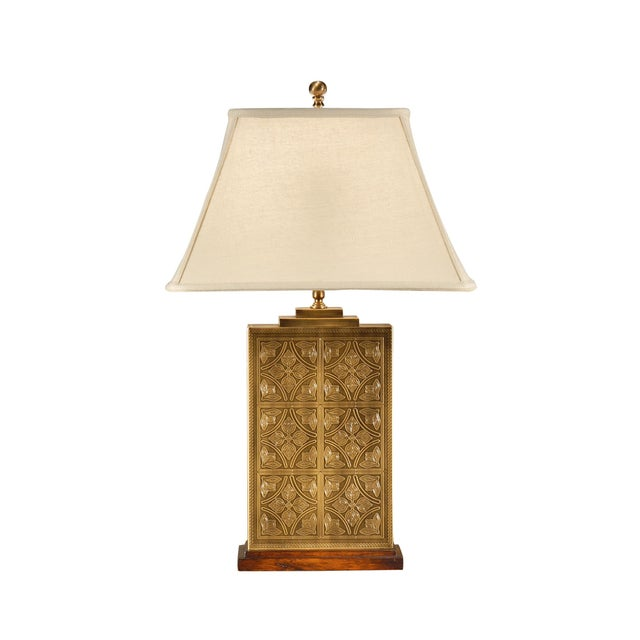 This is the Tea Box lamp by Wildwood Lamps. The piece has been laser etched in brass and features a hand applied patina.