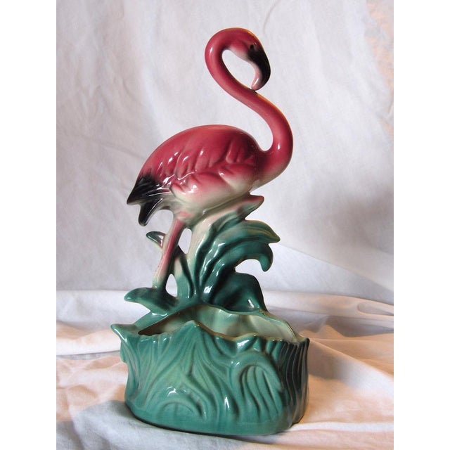 Gorgeously pink!! Standing Flamingo could be used as a vase or planter. No dings or repairs. It is vintage so a tiny bit...