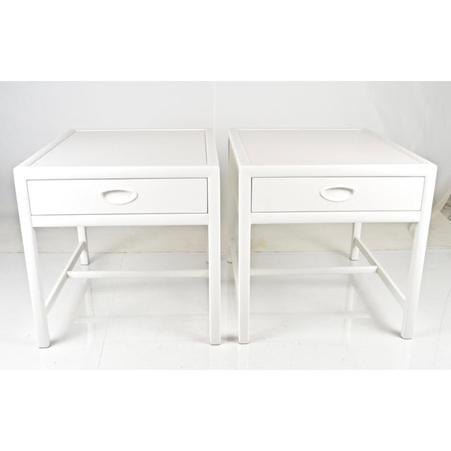 Classic modern single-drawer end tables or bedside tables made by Baker Furniture in the 1950s. Now restored with a new...