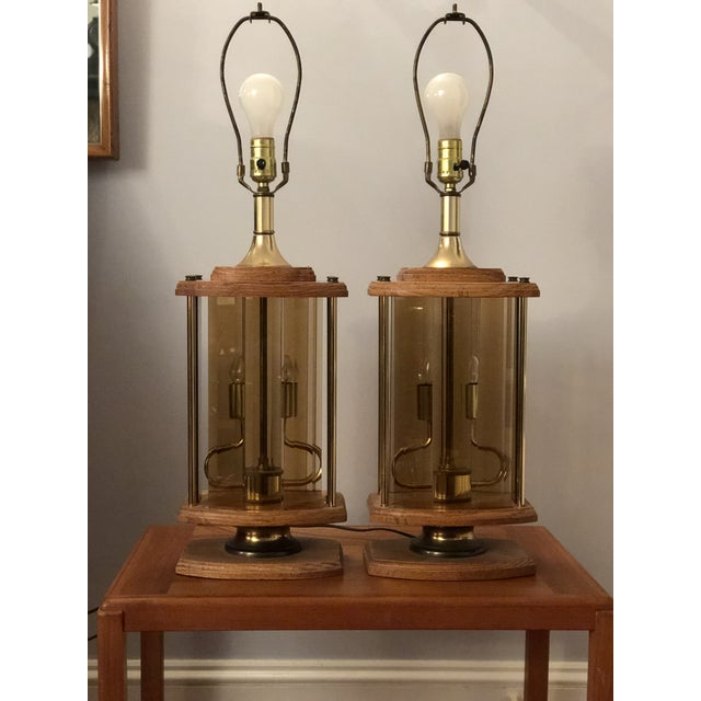 Unique Mid Century Wooden lamps with smoked beveled panes that fit in an upper and lower channel. Multi-task function with...