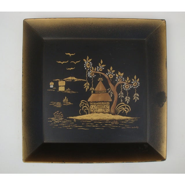 Offered is a lovely midcentury square tole metal tray with a hand painted Asian nautical scene featuring a house on an...