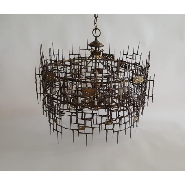 Chandelier is made of bronze welded to vintage mason nails. Lighting source is a repurposed chandelier which consists of 8...