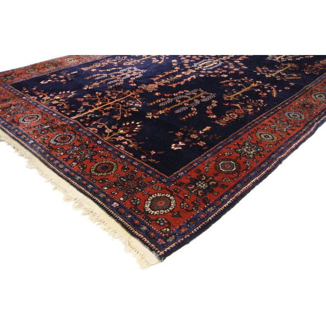Antique Sarouk rugs are the most coveted carpets among style houses for their rich deep ink blue backdrops and elaborate...