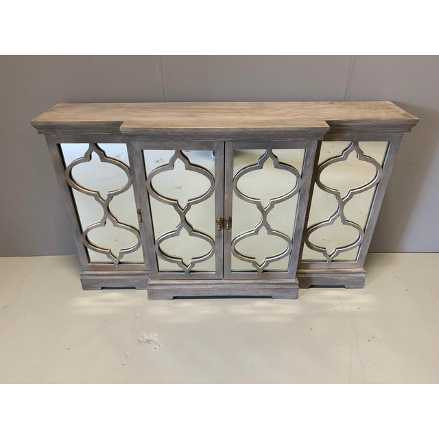The New Gustave sideboard is full of designer details as seen in the mirrored trellis inspired front. This piece is narrow...