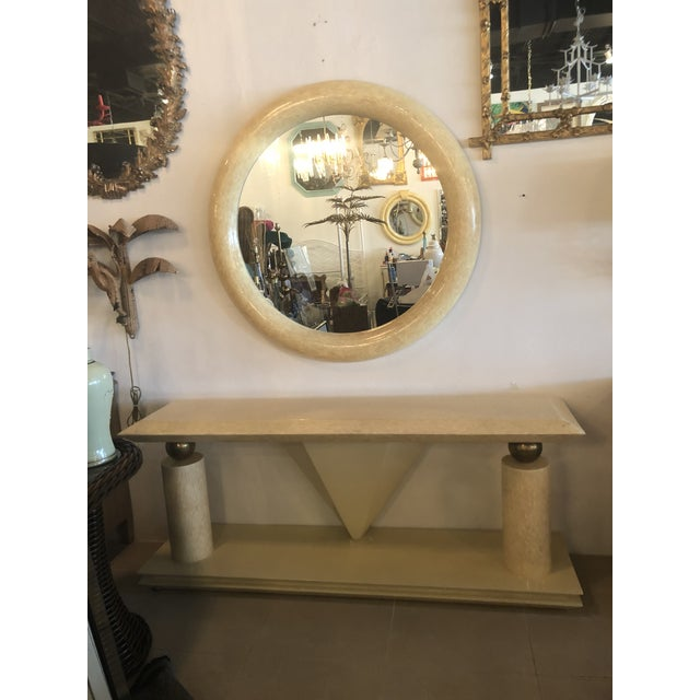 Vintage antler bone console table and round mirror with brass accents. Brass was left original and not polished but can be...