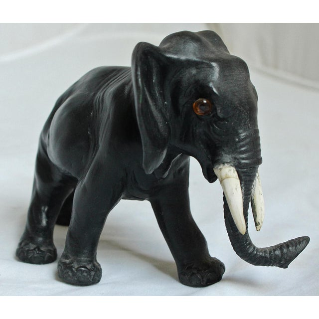 This is a Wedgwood basalt striding elephant with glass eyes, c. 1913. The piece is designed by Ernest W. Light. Marked...