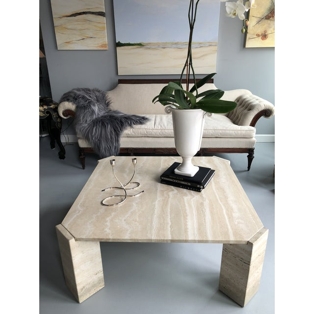 The movement in the stone of this Italian travertine coffee table is beautiful! The neutral color of the stone allows you...