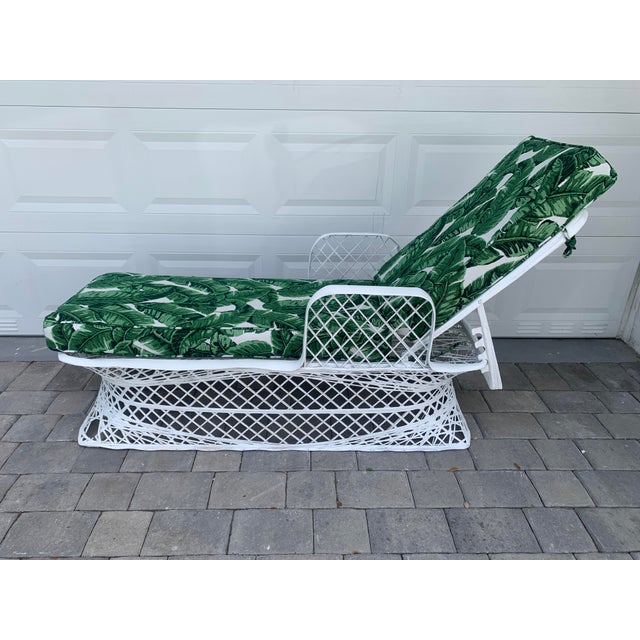 Mid 20th-Century Modern & Iconic spun fiberglass fully retractable chaise lounge chair by Russell Woodard. Bright white...