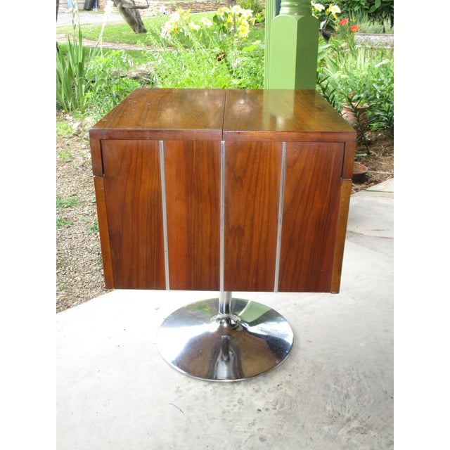 "Very unusual and hard to find walnut swivel bar by Lane Furniture, circa 1978. This too cool bar measures 21"" x 21"" x 27..."