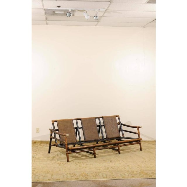 A fabulous restored vintage sofa from a difficult to find series by John Wisner for Ficks Reed. Exceptional rattan and...