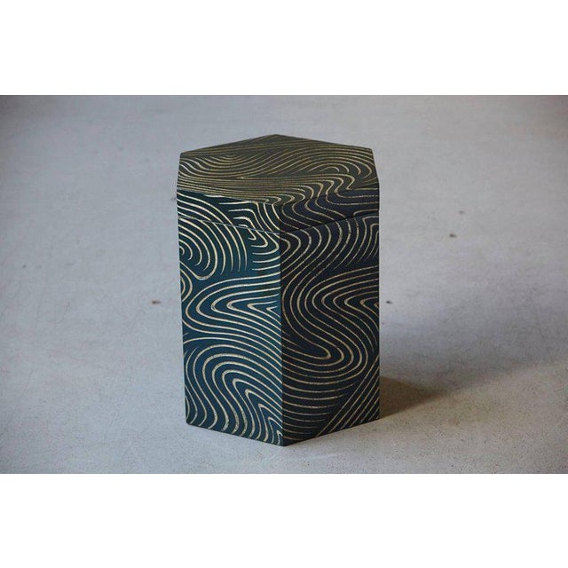 Extraordinary hexagonal box with lid or stool in dark black blue lacquer and engraved gilded graphic waive pattern. The...