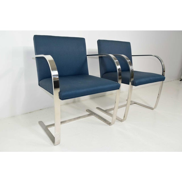 This is a pair of polished stainless steel, Brno chairs by Gordon International.