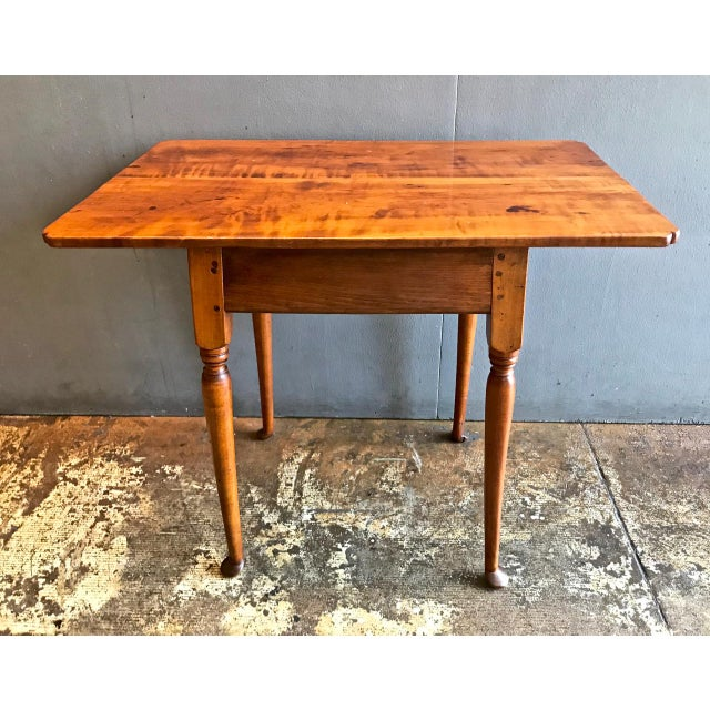 This is a refined example of an 18th century American tiger maple Queen Anne tavern table or side table. The legs are of...