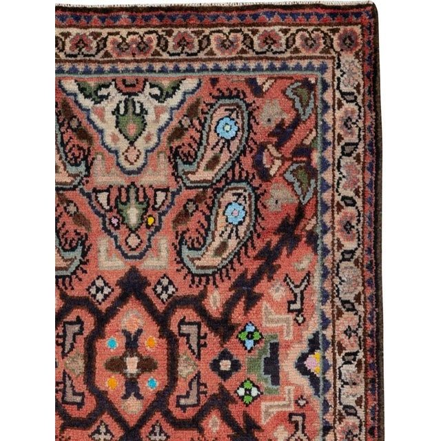 A vintage Persian Hamadan rug from the mid-20th century. Hamadan town and the surrounding weaving area of about 120...