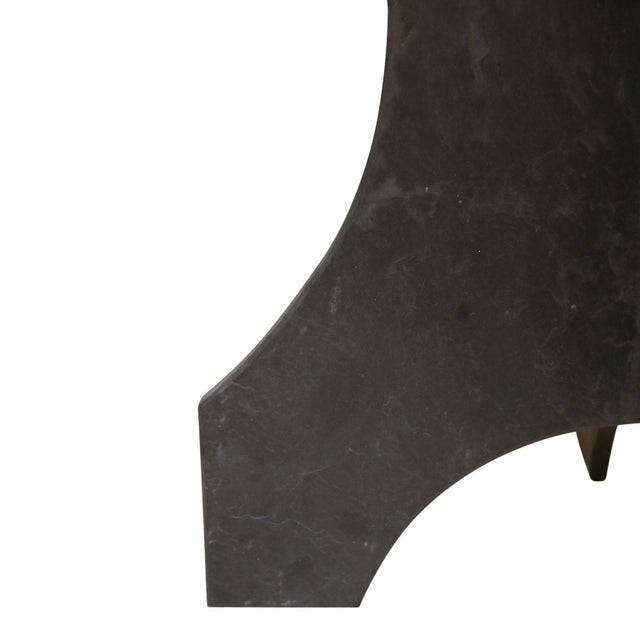 Round slate table from France. Slate top sits upon a two-piece dovetailed slate base.