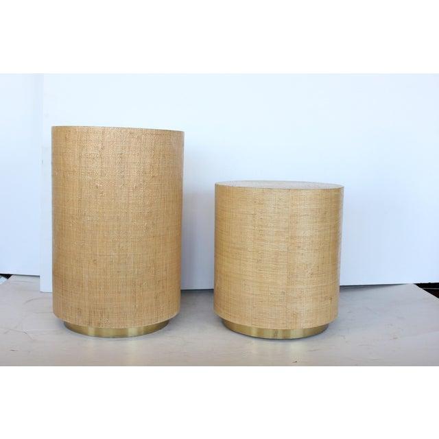 "Karl Springer style modern grasscloth and brass side tables. Measures: Tall H 23"", diameter 15.25"". Short H 17.5"" diameter..."